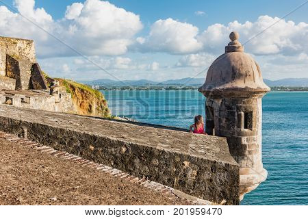 Puerto Rico travel people in Old San Juan, tourist woman visiting Castillo San Felipe del Morro Fortress, touristic attraction on cruise vacation destination. Summer holiday.