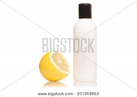 Cosmetic with lemon wadded disk on white background isolation