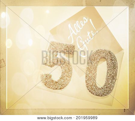 Golden number 50 on cover with German text all the best (Alles Gute)