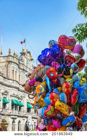 PUEBLA MEXICO - MARCH 1: Balloons for sale in front of the mayor's office in Puebla Mexico on March 1 2017