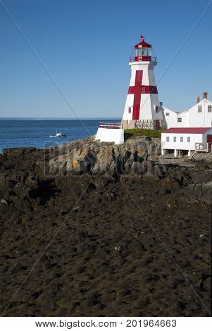 Head Harbor light, also referred to as East Quoddy Head lighthouse, guides mariners around Campobello Island during low tide along the Canadian eastern coast.
