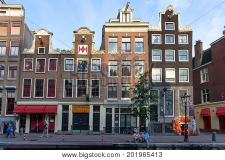 AMSTERDAM - CIRCA JUNE 2014: Historical center of Amsterdam. More than four million tourists visit this city every year. Typical view of Amsterdam central streets