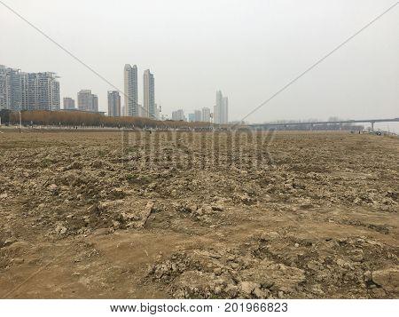 Yangtze river muddy riverbank in Wuhan China