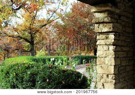 Rock archway leading to the rose garden, lovely fall foilage