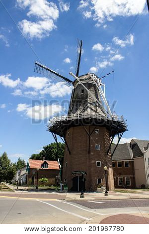 Brick windmill with attached mill, scene from Iowa