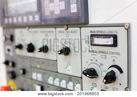 Control panel of cnc metalworking machine center. Selective focus.