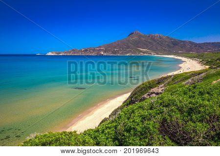 Spiaggia Di San Nicolo And Spiaggia Di Portixeddu Beach In San Nicolo Town, Sardinia, Italy.