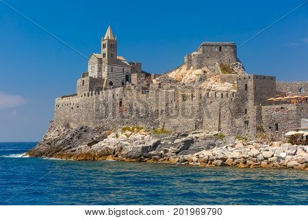 View from sea of Porto Venere with Gothic Church of St. Peter, Italian Riviera, Liguria, Italy.
