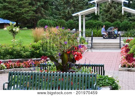 SAINT PAUL, MINNESOTA- AUGUST 2017:  Father and son sitting at a table in the arboretum in St. Paul, MN.