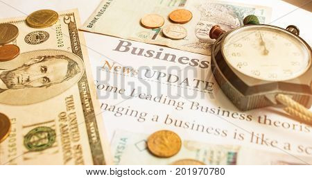 Time is money Analog Clock on Dollars bills Singapore banknotes and papers letter Business News Update Concept of Financial times for saving moneys for futureaTime is money Analog Clock on Dollars bills Singapore banknotes and papers letter Business News
