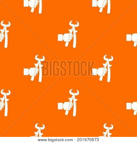 Hand holdimg calipers pattern repeat seamless in orange color for any design. Vector geometric illustration