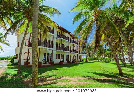 Cayo Coco island, Cuba, Colonial hotel, July 16, 2017, stunning gorgeous amazing view of Colonial hotel grounds, beautiful inviting retro stylish buildings in tropical garden on blue sky background