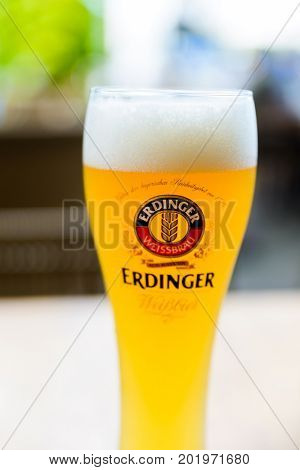 SINGAPORE CITY, SINGAPORE - CIRCA JANUARY 2016: A glass of Erdinger beer at a restaurant terrace.