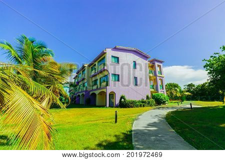 Cayo Coco island, Cuba, Iberostar Mojito resort, July 17, 2017, amazing inviting view of hotel buildings standing in tropical garden on sunny beautiful day