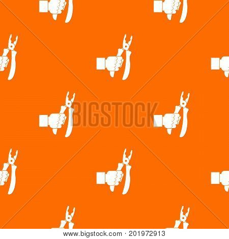 Hand holding chisel pattern repeat seamless in orange color for any design. Vector geometric illustration