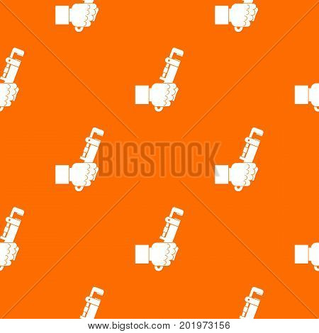 Hacksaw in man hand pattern repeat seamless in orange color for any design. Vector geometric illustration