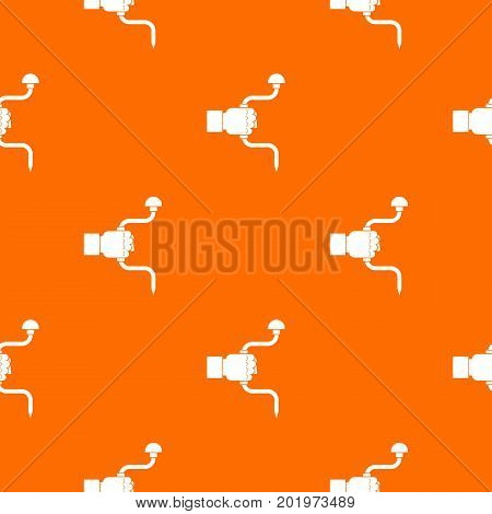 Vintage hand drill in man hand pattern repeat seamless in orange color for any design. Vector geometric illustration