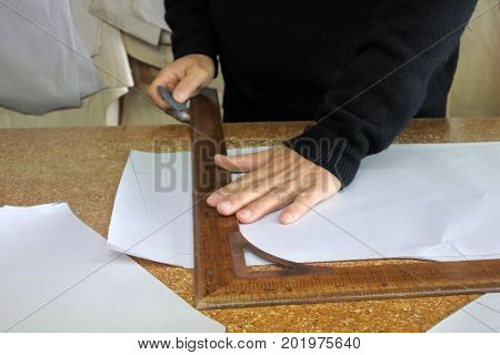 Hands Of Professional Tailor Chalking Measurements