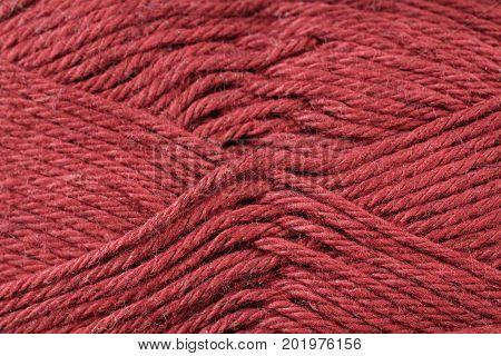 A super close up image of maroon yarn