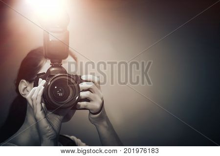 A Self Close Up Shot Of Photographer With A Camera And With Flash In A Mirror.