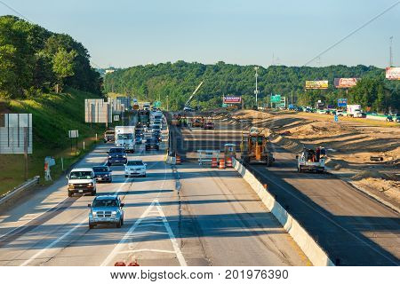 BEDFORD HEIGHTS OH - JUNE 28 2017: Major road construction on I-271 near Cleveland has morning rush hour traffic moving slow.