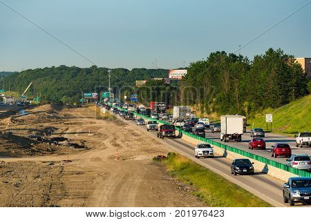 BEDFORD HEIGHTS OH - JUNE 28 2017: Diverted northbound traffic on I-271 near Cleveland during major highway work makes for a congested morning rush hour.