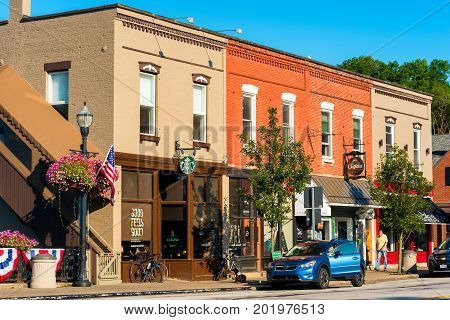 CHAGRIN FALLS OH - JULY 30 2017: A short block of storefronts with varied-colored upper stories forms part of the charming downtown ambiance of this Northeast Ohio village.