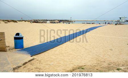 VENTURA CA USA - JULY 4 2013: Blue welcome carpet strip for beachgoers to enjoying holiday at Ventura city beach near Harbor Village Southern California