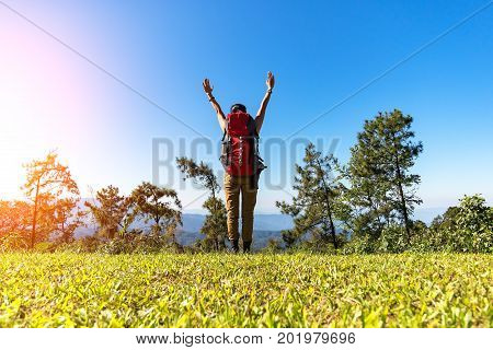 Hiker woman feeling victorious facing on the mountainHiker woman feeling victorious facing in the forest Thailand