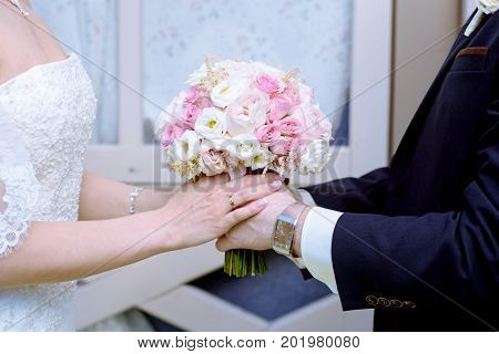 Wedding couple with bouquet. Female and male portrait. Beautiful model girl in white dress. Man in suit. Beauty bride with groom. Woman in bridal gown. Cute lady and guy outdoors