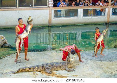 SAMUTPRAKARN THAILAND - FEBRUARY 26 2017 :Unidentified Man show Holding Crocodile At Samutprakan Croc Farm and Zoo.