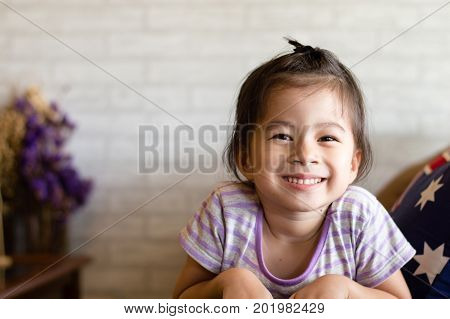 Happy asian girl with smile face in relax time selective focus.