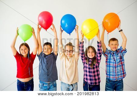 A group of happy children with balloons