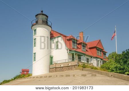 Construction of Point Betsie Lighthouse began in 1854. It was completed in 1858 but wasn't used until 1859. Made of Cream City Brick it was difficult to see during the day. In 1900 the tower and dwelling were painted white while the roof and parapet were
