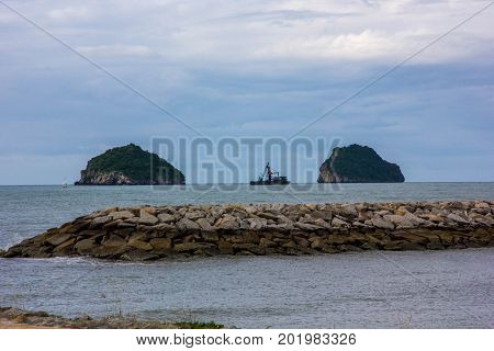The dike and twin mountain in morning time Khlong Wan Prachuap Khiri Khan Thailand