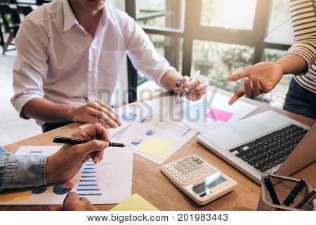 Business adviser analyzing financial with new startup finance project plan co worker team discussing and brainstorming issues to achieve better results working together Group of meeting conference.