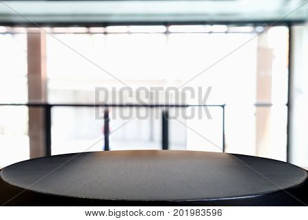 Image of Selected focus empty wooden table and Coffee shop or blurred cafe background of abstract with bokeh image. for montage or display your products.