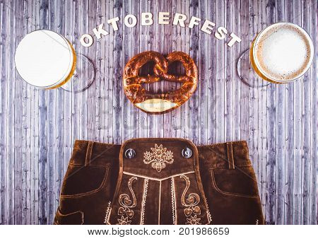 Oktoberfest beer festival on rustic background. Flat lay style.