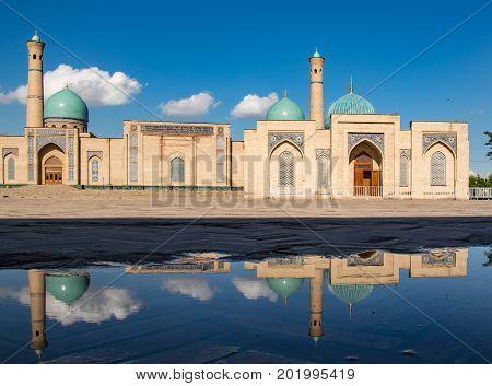 Khast Imam Mosque in Tashkent Uzbekistan with reflection in pond of water