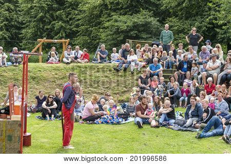 Kids Watching A Theater Show Outdoors