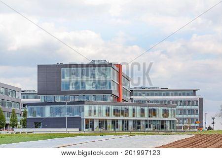 modern office building - exterior view - blue sky