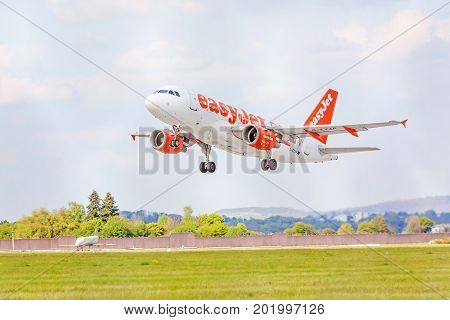 Stuttgart Germany - April 29 2017: Airbus airplane A319-100 from easyJet landing approach / after takeoff - airport Stuttgart sky with clouds in background