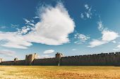 Famous fortification wall surrounding Aigues-Mortes city Camargue France poster