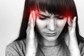 Portrait of a pretty woman over gray background stress and headache having migraine pain black and white with red accent poster