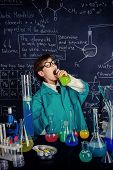 The boy scientist is going to drink the chemical solution he invented. Educational concept. Discovery.  poster