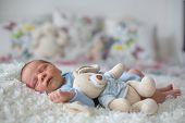 Little newborn baby sleeping with toy baby with scin rash child dermatitis symptom problem rash newborn suffering atopic symptom on skin. concept child health poster