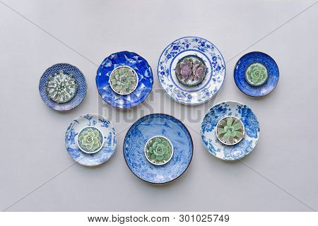 Set Of Ceramic Dishes  With Succulent Plants On Table Background. Top View