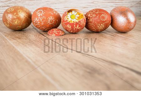 Easter Wooden Background With Row Of Ornate Eggs, Text Space