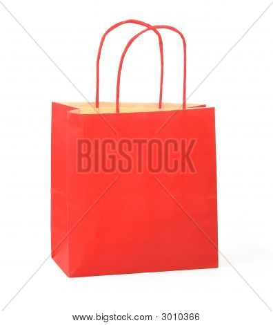 red shopping bag on white background . poster