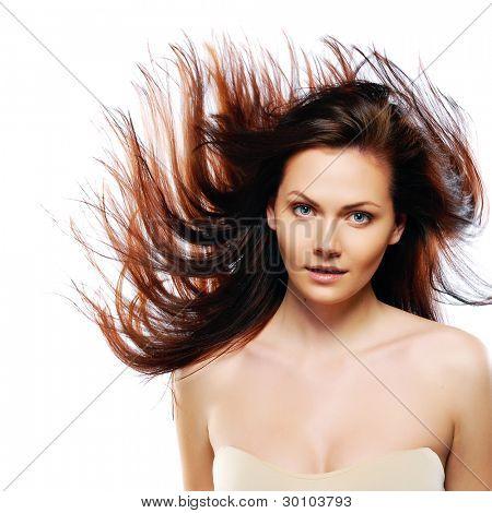 beauty model in studio with hair blown by wind